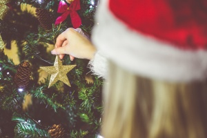 young-woman-decorating-a-christmas-tree-picjumbo-com
